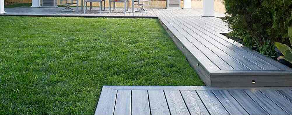 keep grasses from growing under outdoor decking